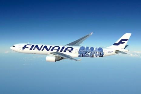 Элементы картины Марии Примаченко на самолете компании FinnAir
